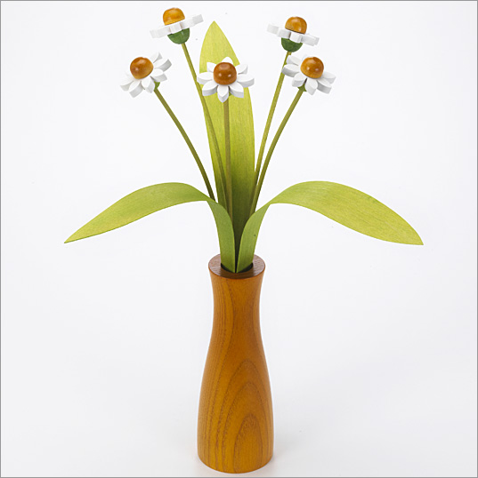 5 white Daisies with 3 green leaves with yellow 'cool' vase