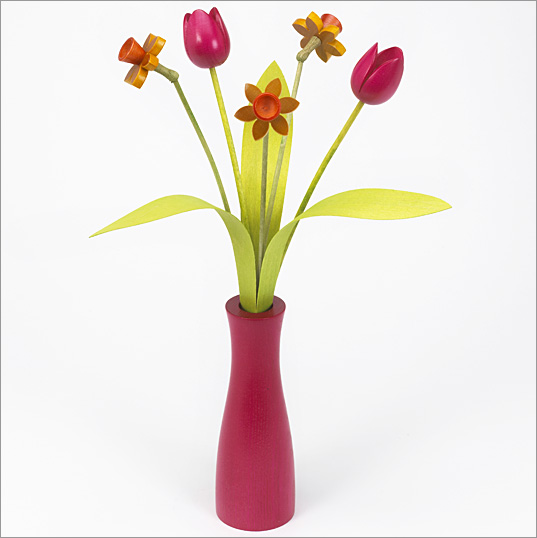 3 yellow Daffodils, 2 pink Tulips with 3 green leaves with pink 'cool vase