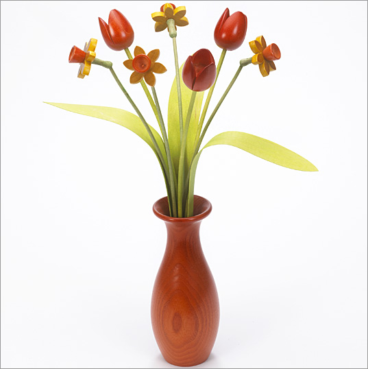 4 yellow Daffodils, 3 orange Tulips with 3 green leaves with orange 'classic' vase