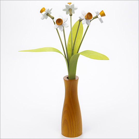 5 white Daffodils with 3 green leaves with yellow 'cool' vase