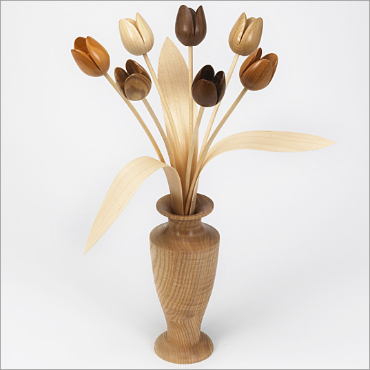 7 mixed natural wood Tulips, Ash 'roman' vase with 3 leaves