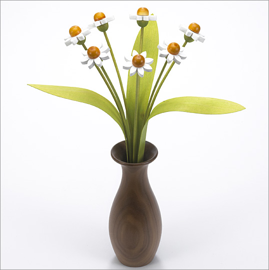 7 white Daisies with 3 green leaves with Walnut 'classic' vase